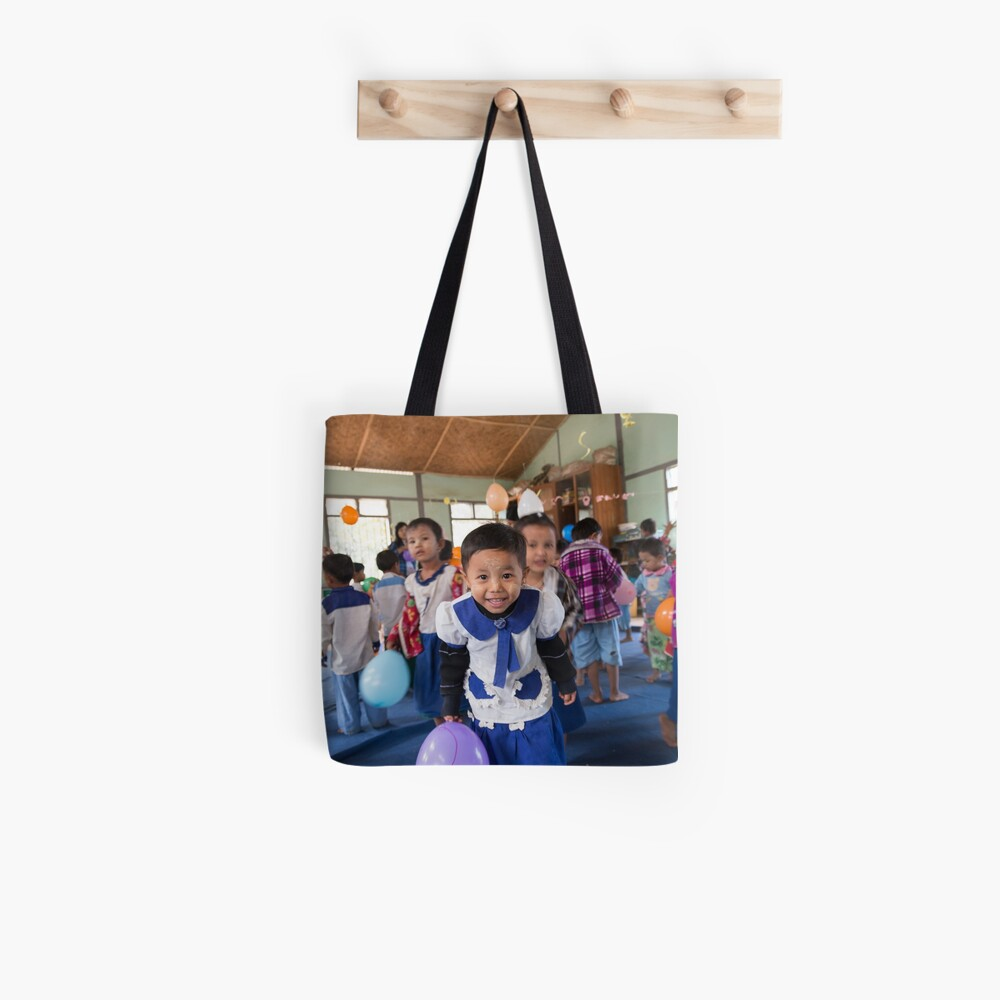 Preschoolers playing with Balloons in Myanmar Tote Bag