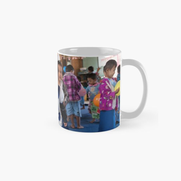 Preschoolers playing with Balloons in Myanmar Classic Mug
