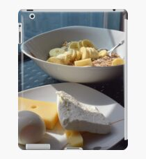 A bowl of cereals and yogurt and a plate with cheese and eggs. iPad Case/Skin