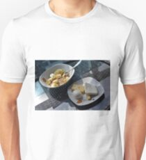 A bowl of cereals and yogurt and a plate with cheese and eggs. Unisex T-Shirt