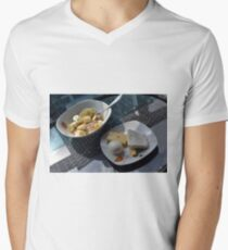 A bowl of cereals and yogurt and a plate with cheese and eggs. Mens V-Neck T-Shirt