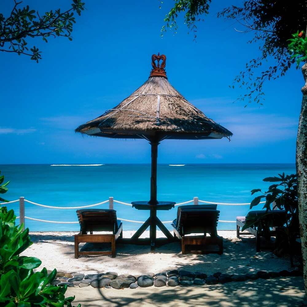 Beach umbrella and recliners, Bali, Indonesia. by johnecclesphoto