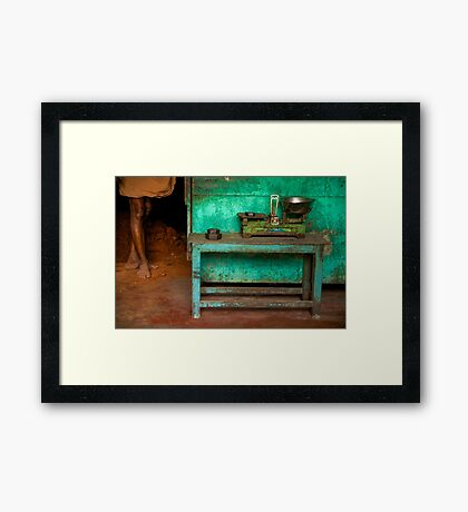 Weighing It Out Framed Print