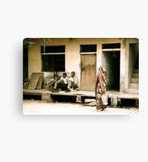 Three Men and a Sari Canvas Print