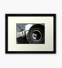 Camera in action. Framed Print