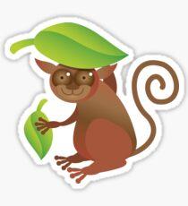 A TARSIER wild animal of the Phillipines hiding under leaves Sticker