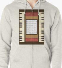 Piano keys with sheet music by Kristie Hubler Zipped Hoodie