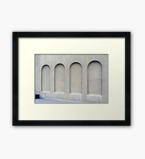 Arches on a wall. Framed Print