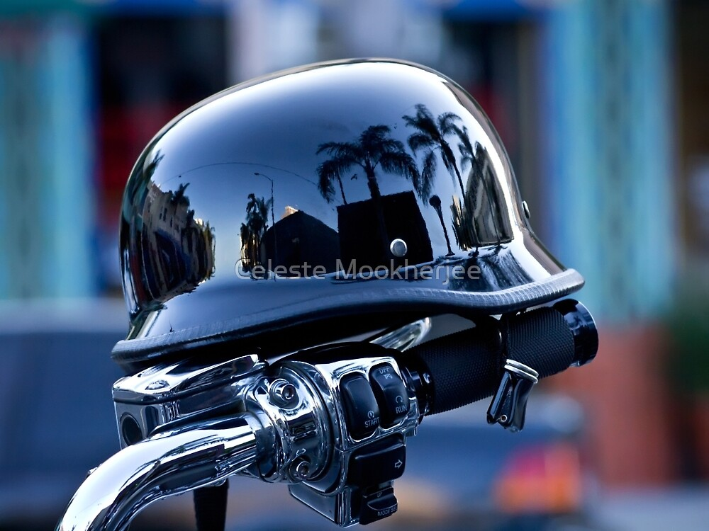 Motorcycle handlebar with reflective helmet by Celeste Mookherjee