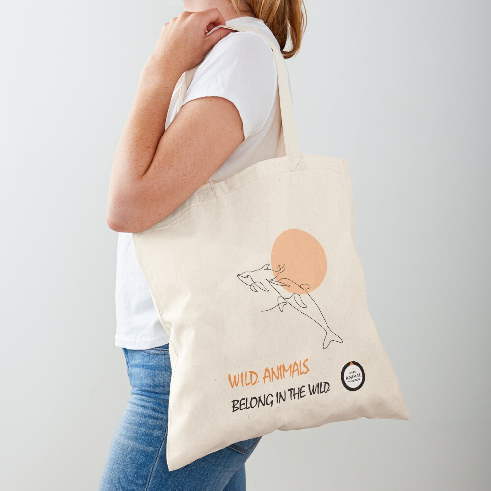 Dolphins belong in the wild Tote Bag