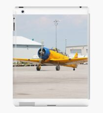 Single engine trainer North American Harvard IV rolling to location for stop. iPad Case/Skin