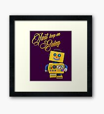 Just keep on going - funny toy robot Framed Print