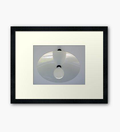 A black lamp white inside Framed Print