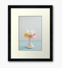 Three cupcakes on cake stand Framed Print