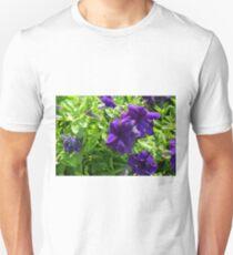 Dark purple flowers natural background. T-Shirt