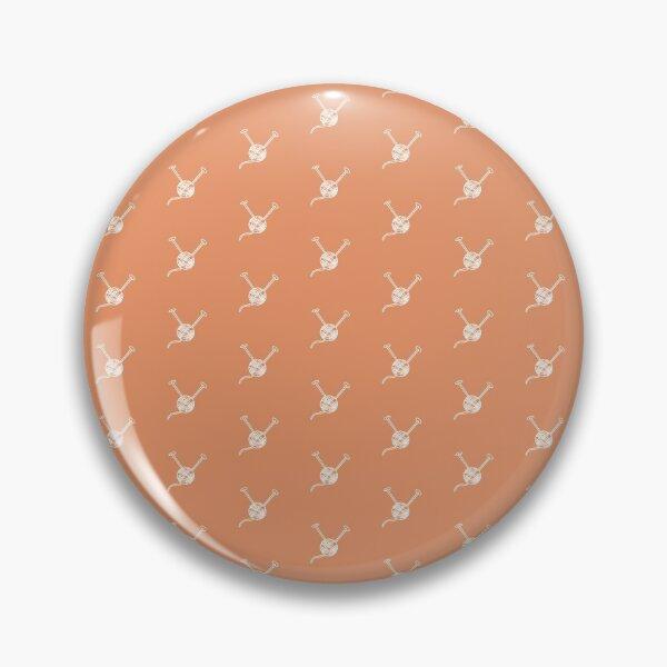 Cartoon yarn ball orange white  print Pin