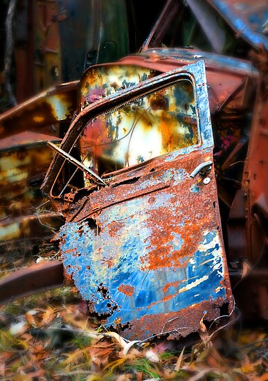 Rusted old car door abandoned in scrap yard by Graeme Black