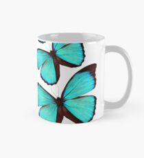 Light blue butterflies in a spiral Mug
