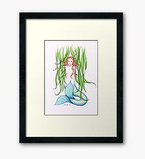 Mermaid looking through the weeds Framed Print