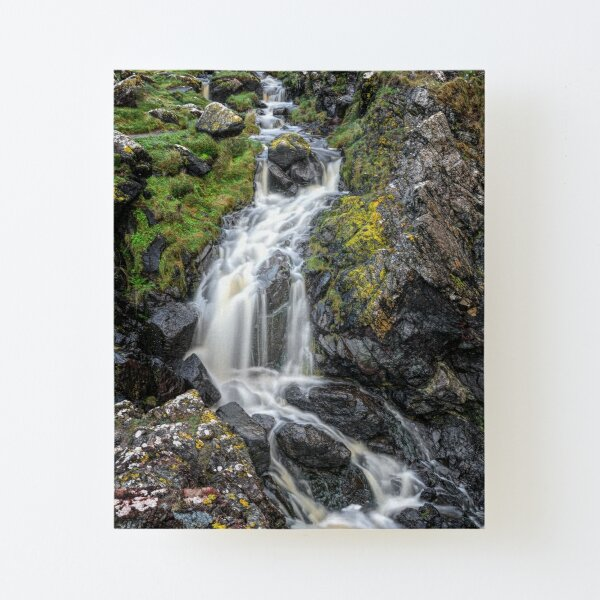The cliffside waterfall at Kynance Cove, Cornwall Canvas Mounted Print