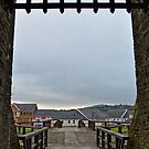 Welch Caerphilly Castle in Wales - Gate Bridge in the morning view to Caerphilly by Remo Kurka