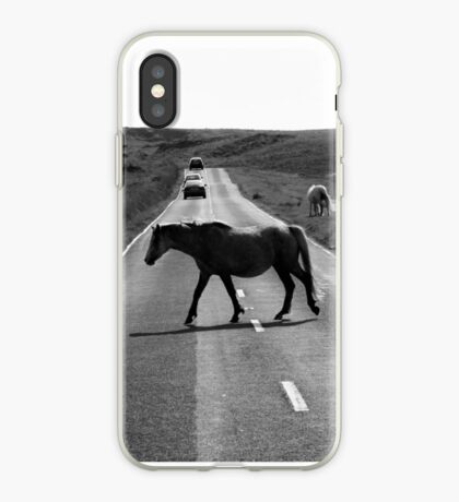 Horse crossing a road in Swansea`s Gower, protected area in Wales iPhone Case