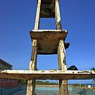 Olympic Swimming Pool, empty and broken down, with tower. Seen in Ghana, West Africa by Remo Kurka