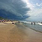 Storm clouds of an tropical hurricane bringing heavy rain over West Africa. Seen on a beach. by Remo Kurka