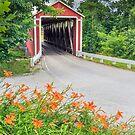 Covered Bridge and Orange Roadside Lilies by Kenneth Keifer