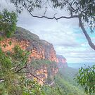 Mountains Cliff With Natural Frame by Michael Matthews