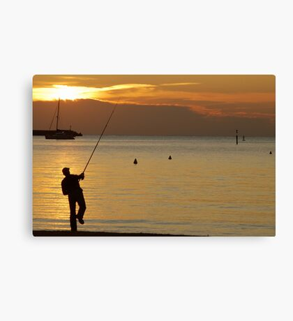 Fisherman in the evening sun Canvas Print