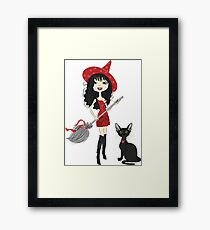 Girl witch with black cat Framed Print