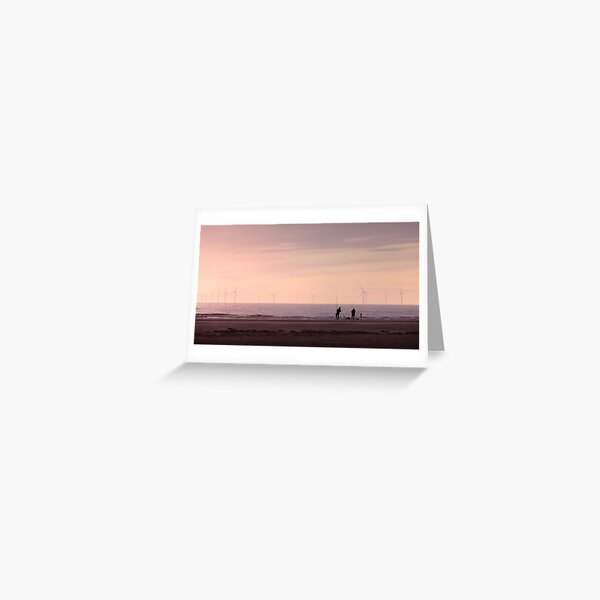 Pulling in the catch as the Sun Sets in Hoylake Greeting Card