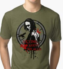 Victims... Aren't we all (2nd version) Tri-blend T-Shirt