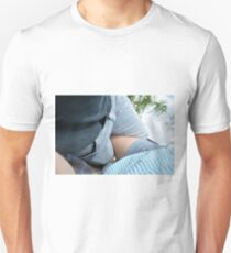 Young couple at a picnic in the park. Unisex T-Shirt