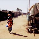 Carrying Fish on the Streets of Kayar Senegal by Wayne King