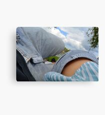 Couple lying on a blanket in the park at a picnic. Canvas Print