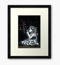 Girl blowing hearts by Banksy Framed Print