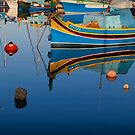 Reflection at Marsaxlokk by Christian  Zammit