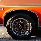 Orange Chevy Nova coupe left side front wheel by htrdesigns