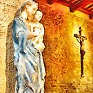 Pieve di Tho: statue of the Madonna with child and crucifix by Giuseppe Cocco