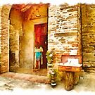 Pieve di Tho: entrance church with woman by Giuseppe Cocco