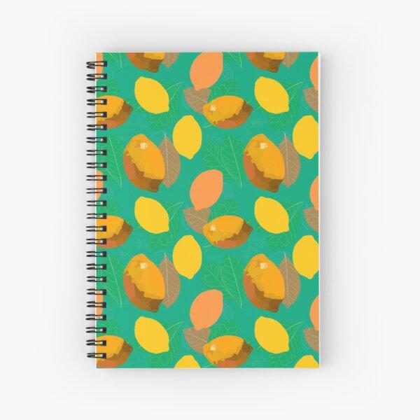 Warm yellow lemons and green leafs on mint green background. Spiralblock
