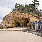 Waterfall Flowing into the Pacific Ocean by Jeff Goulden