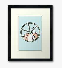 Hamster Sleeping in Exercise Wheel Framed Print