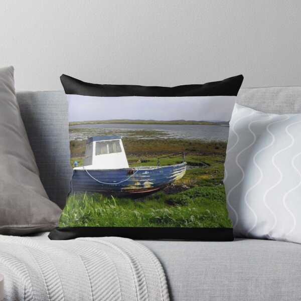 Beached blue boat at East Loch Roag Throw Pillow