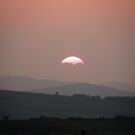 Setting Sun over Fahan, Donegal,Ireland.  by mikequigley