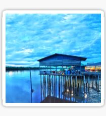 rural fishing cabin by the lake in the morning Sticker