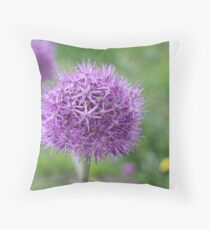 onion flower close to Throw Pillow