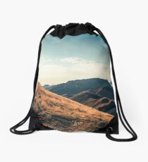 Mountains in the background XXIII Drawstring Bag